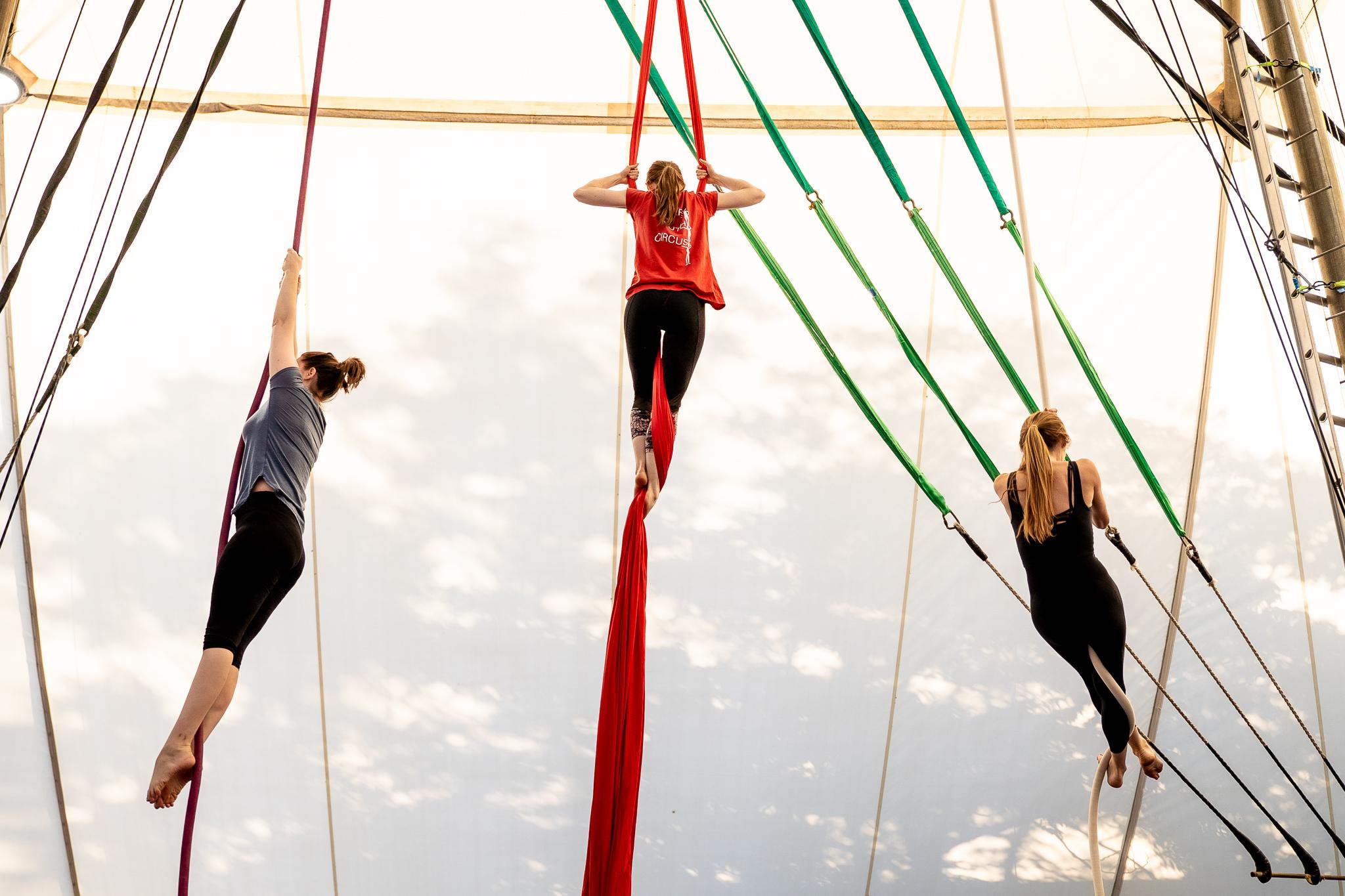 3 people climb aerial apparatus'