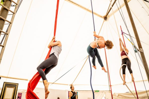 3 people do trick on aerial rope and silks