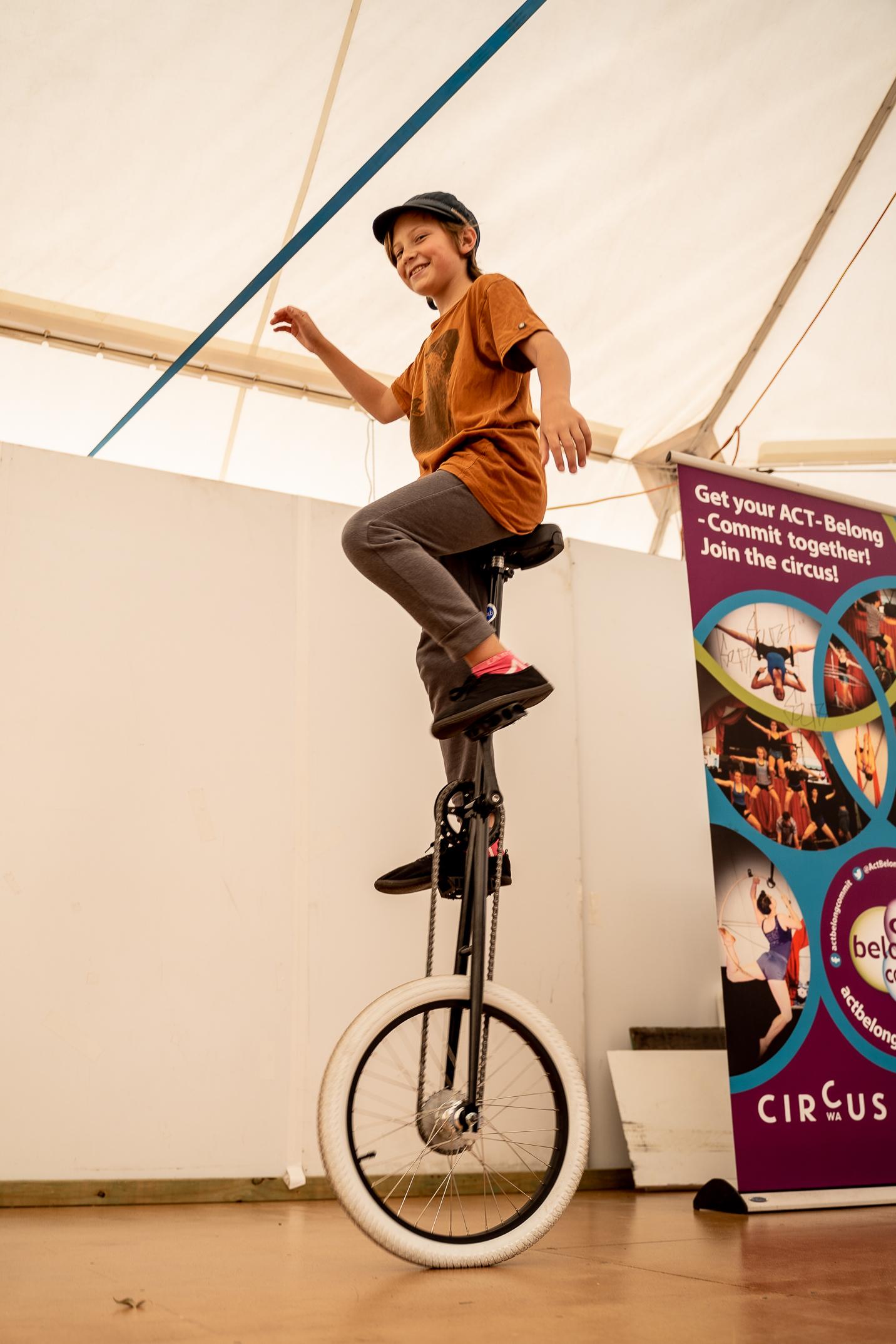 A boy rides a giraffe unicycle