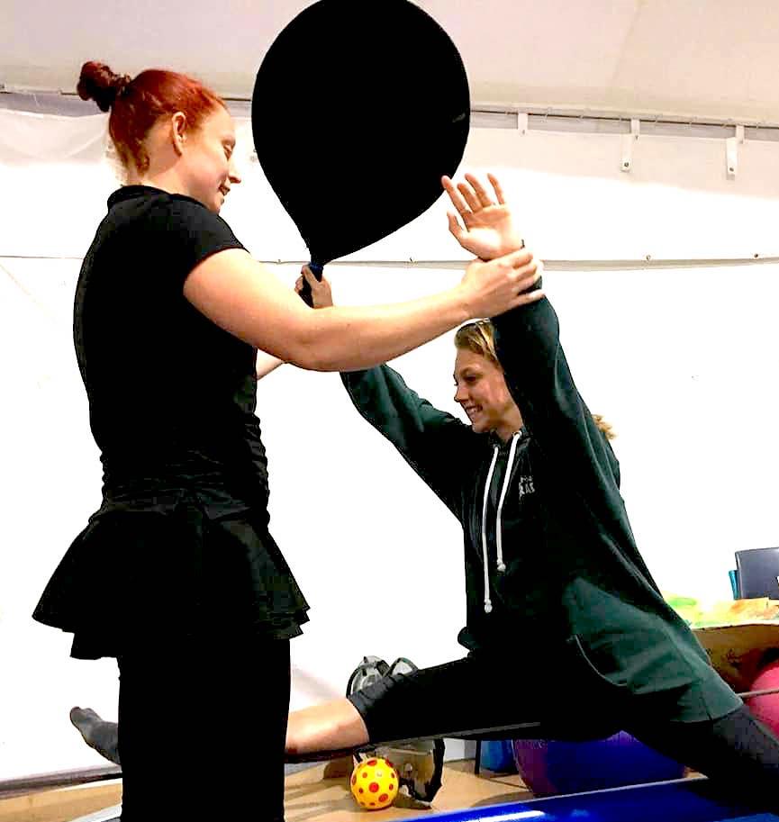 a woman teaches tightwire
