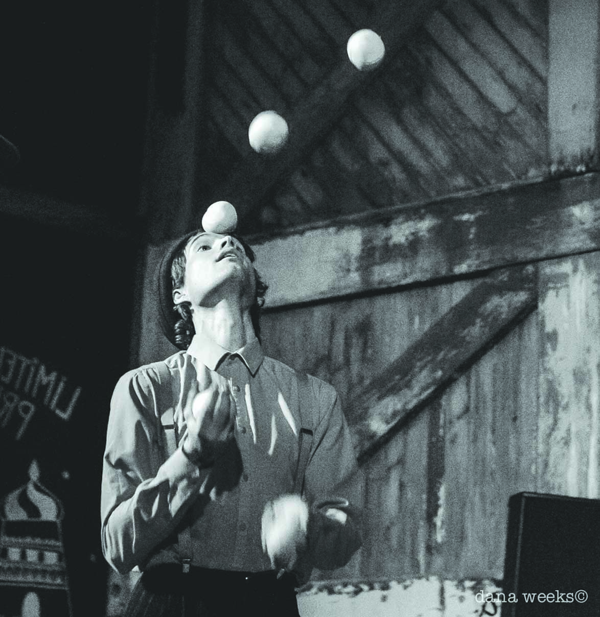 a young man juggling, image is black and white